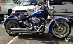 2010 FLSTN Softail Deluxe with custom ice blue paint