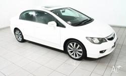 Sporty sedan with luxurious leather, sunroof, alloy