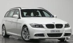 This 2011 BMW 320i M-Sport Wagon is a 2.0 litre 4cyl