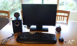 Monitor with detachable stand. Keyboard with extension.