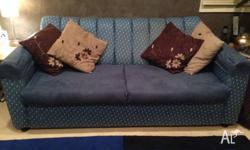 Comfortable sofa bed - double - predominately blue and