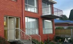 This neat and tidy 2 bedroom upstairs unit is located
