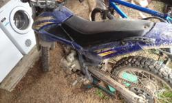 200cc dirt bike, runs well. needs new bolts for the