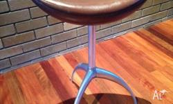 Custom made brown leather stools from New Zealand.
