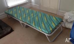2 Folder beds, suitable as spare beds for children.