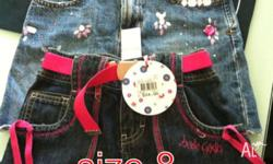 2 Girls skirts, size 8, 1 is brand new with tags, the