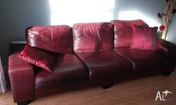 2 of burgundy leather lounge, one is 3 seater the other