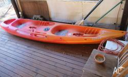 Selling our 2 seater kayak with paddles. Moving