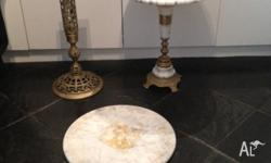 2 small marble tables. The one that is together has a