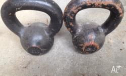 A set of 2 cast iron kettle bells. Has some rust on