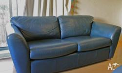 Up for sale is a matching set of navy leather sofas. 1