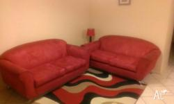 2 x two and a half seater sofas. Colour red suade.
