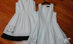 2x Girl's Dresses with Cat Print on Hem Size 7, good