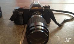 Canon T50 w/ sigma 70-210 (works perfect just need tape