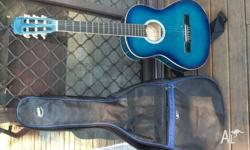 3/4 acoustic guitar .Teal colour comes with strap and