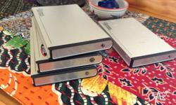 Three 2.5 PATA hard drive cases. ( plus an extra one