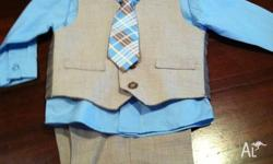Gorgeous 3 piece suit. Size 18 months. Never worn!