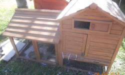 large hutch with 3 grown female rabbits. 2 other