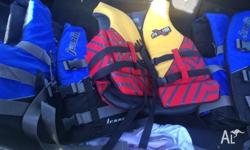 Up for sale are 3 life jackets all in excellent