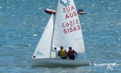 420 sailing dinghy for sale. 3 sets of sails, new mast