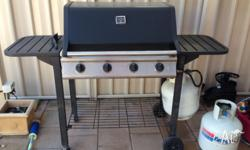 4 Burner BBQ. 3 Years old. Split plate and grill with