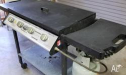 A 4 burner BBQ in very good condition; comes with