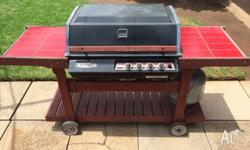 4 Burner BBQ on wooden trolley with in-test 9KG gas