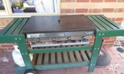 Well loved 4-burner flat top BBQ. Portable. Cover and