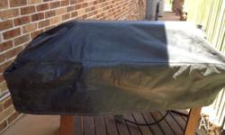 4 Burner BBQ with roasting hood and heavy duty cover.