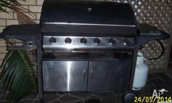 4 burner BBQ in good condition. Additional burner on