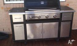 4 burner BBQ with wok burner and rotisary. BBQ cover