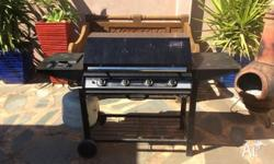 4 burner gas BBQ/ with hood and side wok burner. In