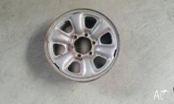Four steel rims originally bought for a trailer for a