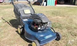 "4hp Briggs & Stratton engine on 18 "" metal cut base ."