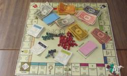 A collection of old games which includes a old Monopoly