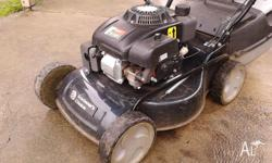 4 STROKE LAWN MOWER AND CATCHER 4 BLADE CUT BIG
