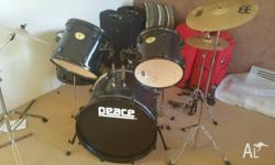 Hi I am selling my daughter's Peace Drum Kit good for