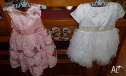 Both dresses are 6 - 12 mth size and have only been