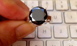 Carat / weight: 6.55cts Cut / shape: round brilliant