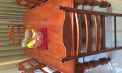 7 piece wooden dining table for sale. Thick, heavy