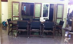 8 seater wooden table with wood director style chairs