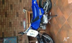 its a blue and white 90cc semi-auto motorbike its