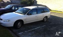 White, auto, 7 months redjo, air con, power steering,