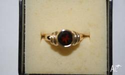 Ladies 9 ct Garnet ring - full rubover setting with