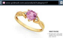 9ct gold ring with pink sapphire stone. Only worn three
