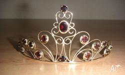 This one of 9ct yellow gold tiara one rubbed in and is