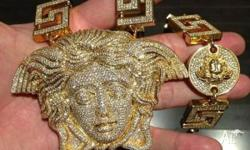 A yellow gold 135 grams versace medusa chain Contact