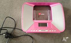 Pink iPod dock which runs off a power cord. It can be