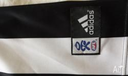 COLLINGWOOD Magpies football club boys size 14 top.