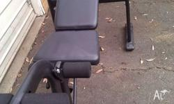 Adjustable bench press with leg attachment and plates